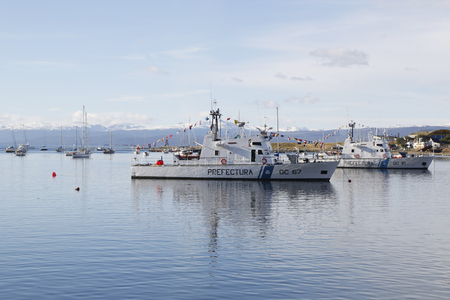 argentinian: USHUAIA, ARGENTINA - APRIL 2, 2015: Argentinian Coast Guard boat GC 67 Rio Uruguay and GC 81 Canal Beagle Class Z-28 the Naval Prefecture Argentina in Ushuaia Harbor during Malvinas Day Celebration