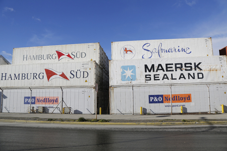 USHUAIA, ARGENTINA - APRIL 2, 2015: Stacked cargo containers in storage area of freight sea port terminal in Ushuaia, Argentina.