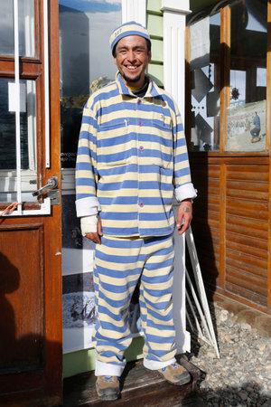 tour guide: USHUAIA, ARGENTINA - APRIL 2, 2015: Tour guide dressed as prisoner in Ushuaia, Argentina