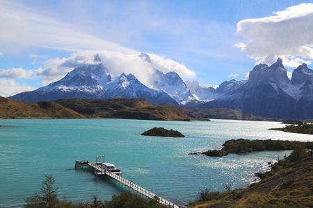 alpenglow: The Cuernos del Paine Horns of Paine and Lake Pehoe in Torres del Paine National Park, Patagonia, Chile
