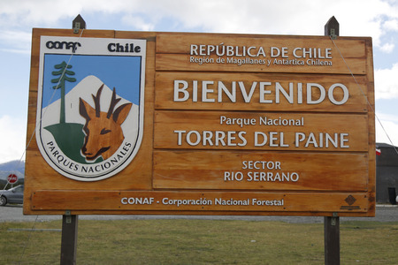 alpenglow: TORRES DEL PAINE, CHILE - APRIL 4, 2015: Sign at the entrance of Torres del Paine National Park, Patagonia, Chile