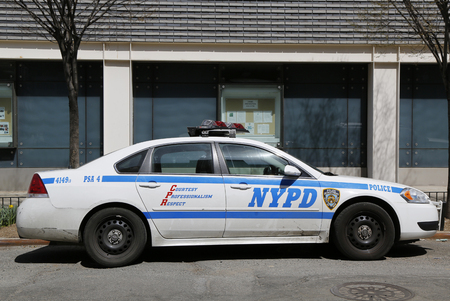 new world order: NEW YORK - APRIL 16, 2015: NYPD car provide security in Lower Manhattan