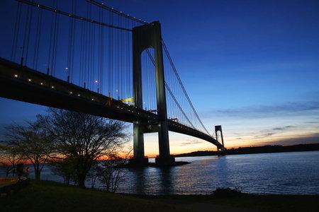 staten: NEW YORK - NOVEMBER 27, 2015: Verrazano Bridge in New York. The Verrazano Bridge is a double-decked suspension bridge that connects the boroughs of Staten Island and Brooklyn