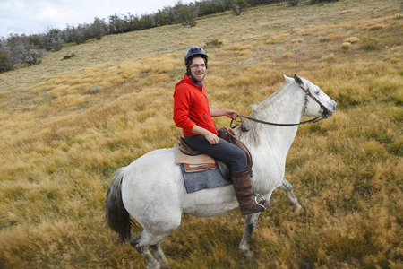 chaco: TORRES DEL PAINE, CHILE - APRIL 7, 2015: Gaucho in Torres del Paine National Park, Patagonia, Chile. Gaucho is a resident of the South American pampas, Gran Chaco, or Patagonian grasslands