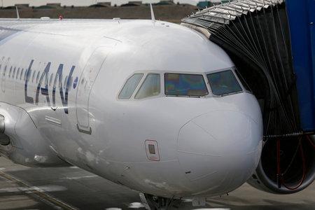 punta arenas: PUNTA ARENAS, CHILE - APRIL 9, 2015: Lan airlines aircraft at the gate at Presidente Carlos Ibanez del Campo International Airport in Punta Arenas, Chile