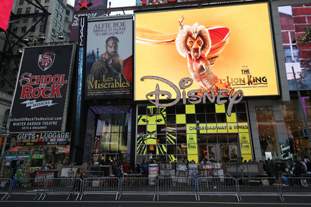 annie: NEW YORK - DECEMBER 13, 2015: Broadway signs in Manhattan. With over 40 prominent theater houses, Broadway theater is considered one of the world s highest levels of commercial theater