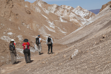 backpackers: ATACAMA DESERT, CHILE - APRIL 10, 2015: Backpackers exploring the Moon Valley in Atacama Desert, Chile