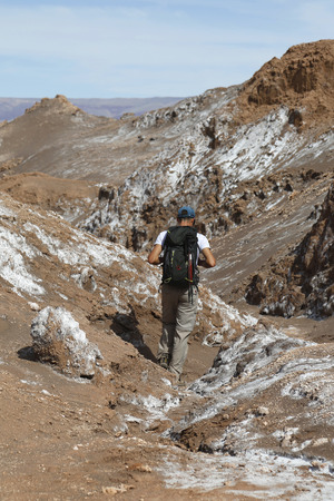 moon  desert: ATACAMA DESERT, CHILE - APRIL 10, 2015: Backpacker exploring the Moon Valley in Atacama Desert, Chile