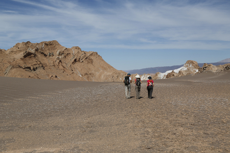 moon  desert: ATACAMA DESERT, CHILE - APRIL 10, 2015: Backpackers exploring the Moon Valley in Atacama Desert, Chile
