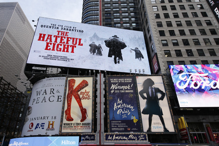 annie: NEW YORK - DECEMBER 25, 2015: Broadway signs in Manhattan. With over 40 prominent theater houses, Broadway theater is considered one of the world s highest levels of commercial theater