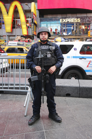counter terrorism: NEW YORK - DECEMBER 25, 2015: NYPD counter terrorism officer providing security at Times Square in Midtown Manhattan Editorial
