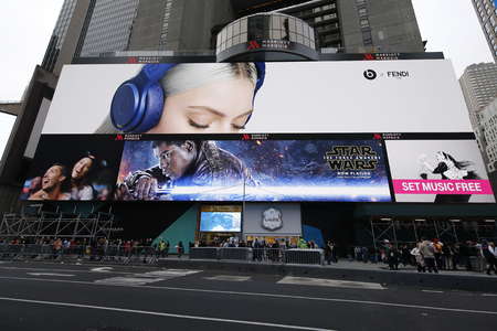 famous industries: NEW YORK - DECEMBER 25, 2015: Star Wars The Force Awakens  movie billboard on Broadway at  Times Square in Manhattan