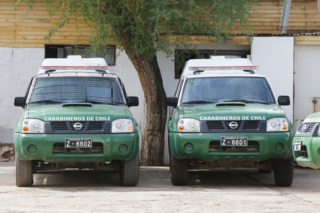 police force: SAN PEDRO DE ATACAMA, CHILE - APRIL 10, 2015: Carabineros de Chile cars on the street at San Pedro de Atacama. The Carabiniers of Chile are the uniformed Chilean national police force and gendarmerie.