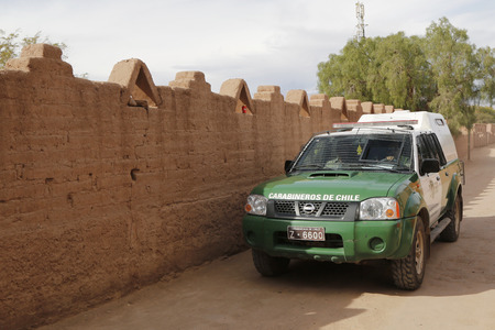 police force: SAN PEDRO DE ATACAMA, CHILE - APRIL 10, 2015: Carabineros de Chile car on the street at San Pedro de Atacama. The Carabiniers of Chile are the uniformed Chilean national police force and gendarmerie.