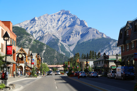 banff: BANFF, CANADA - JULY 29, 2014: The famous Banff Avenue in Banff National Park. Banff is a resort town and one of Canadas most popular tourist destinations Editorial
