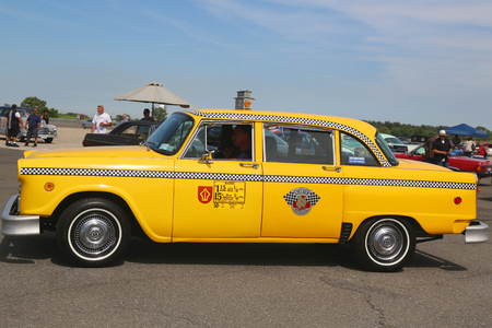 checker: BROOKLYN, NEW YORK - JUNE 8, 2014: Checker Taxi Cab produced by the Checker Motors Corporation on display at the Antique Automobile Association of Brooklyn annual Spring Car Show