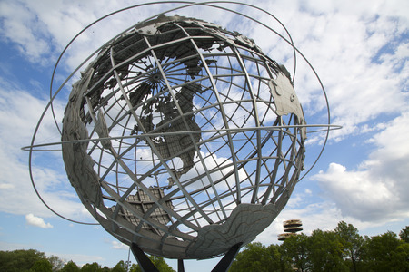 flushing: NEW YORK - MAY 18, 2014: 1964 New York World s Fair Unisphere in Flushing Meadows Park. It is the world s largest global structure, rising 140 feet and weighing 700 000 pounds