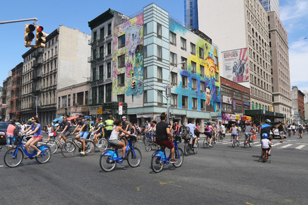 outdoor training: NEW YORK - AUGUST 8, 2015: Bicyclists at Lafayette Avenue during Summer Streets Saturday in New York. Summer Streets is an annual celebration of New York City s most valuable public space our streets