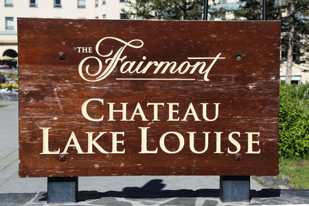 louise: LAKE LOUISE, CANADA - JULY 27, 2014: Sign of the famous Fairmont Chateau Lake Louise Hotel. Lake Louise is the second most-visited destination in the Banff National Park. Editorial
