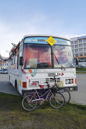 southernmost: USHUAIA, ARGENTINA - APRIL 2, 2015: Tourist bus with canoe on the roof in Ushuaia. Ushuaia is described as the southernmost city in the world
