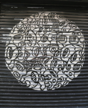 lower east side: NEW YORK - MAY 14, 2015: Mural art at Delancey Street in Lower East Side in Manhattan. A mural is any piece of artwork painted or applied directly on a wall, ceiling or other large permanent surface