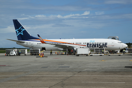 cana: PUNTA CANA, DOMINICAN REPUBLIC - JANUARY 4, 2016: Air Transat airlines Boeing 737 at Punta Cana International Airport. Punta Cana Airport currently serves as a destination for 53 different airlines