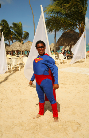 cana: PUNTA CANA, DOMINICAN REPUBLIC - DECEMBER 31, 2015: Member of  Majestic Elegance Punta Cana entertainment team on the beach in Punta Cana Editorial