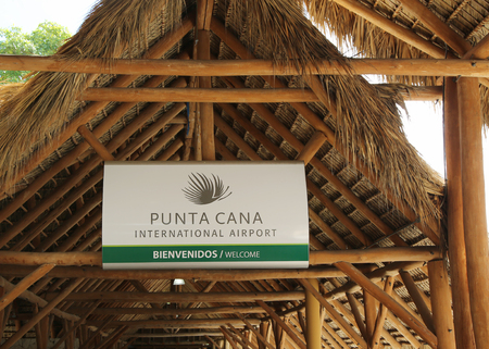 cana: PUNTA CANA, DOMINICAN REPUBLIC - DECEMBER 30, 2015: Welcome to Punta Cana International Airport sign.. The Dominican Republic is the most visited destination in the Caribbean