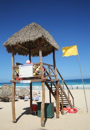cana: PUNTA CANA, DOMINICAN REPUBLIC - JANUARY 3, 2016:  Lifeguard tower at Bavaro Beach in Punta Cana