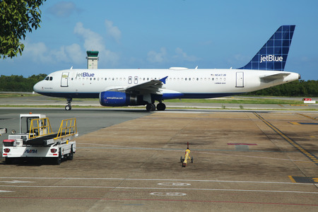 jetblue: PUNTA CANA, DOMINICAN REPUBLIC - JANUARY 4, 2016: Jetblue Airlines Airbus 320 on tarmac at Punta Cana International Airport. The Dominican Republic is the most visited destination in the Caribbean