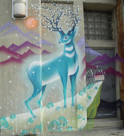 NEW YORK - JANUARY 7, 2016: Mural art in Queens, New York. A mural is any piece of artwork painted or applied directly on a wall, ceiling or other large permanent surface