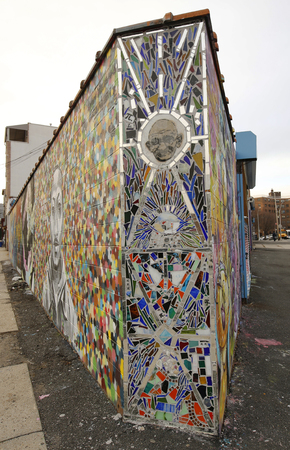 NEW YORK - JANUARY 7, 2016: Mural art at Wellington Court in Astoria section in Queens. A mural is any piece of artwork painted or applied directly on a wall, ceiling or other large permanent surface Sajtókép