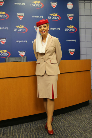 billie: NEW YORK - AUGUST 29, 2015: Emirates Airline flight attendant at the Billie Jean King National Tennis Center during US Open 2015 in New York