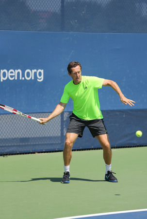 billie: NEW YORK - AUGUST 25, 2015: Swedish coach Jonas Bjorkman coaching Andy Murray for US Open 2015 at Billie Jean King National Tennis Center in New York Editorial