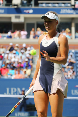 us open: NEW YORK- SEPTEMBER 1, 2015: Professional tennis player Caroline Wozniacki of Denmark in action during US Open 2015 first round match  at Arthur Ashe stadium in New York Editorial