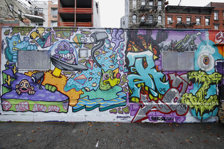 bowery: NEW YORK - JANUARY 10, 2016: Mural art at Houston Avenue in Lower Manhattan. A mural is any piece of artwork painted or applied directly on a wall, ceiling or other large permanent surface