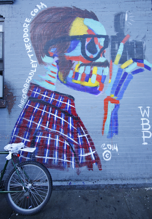 collectives: NEW YORK - JANUARY 10, 2016: Mural art in Lower East Side in Manhattan. A mural is any piece of artwork painted or applied directly on a wall, ceiling or other large permanent surface