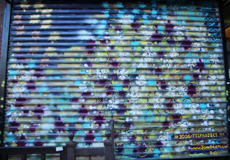bowery: NEW YORK - JANUARY 10, 2016: Mural at 100 gates project in Lower East Side in Manhattan. A mural is any piece of artwork painted or applied directly on a wall, ceiling or other large permanent surface