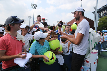 grand hard: NEW YORK - SEPTEMBER 1, 2015: Professional tennis player Ivo Karlovic of Croatia signing autographs after his first round match at US Open 2015 at Billie Jean King National Tennis Center in New York