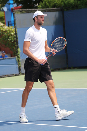billie: NEW YORK - SEPTEMBER 1, 2015: Professional tennis player Ivo Karlovic of Croatia in action during his first round match at US Open 2015 at Billie Jean King National Tennis Center in New York