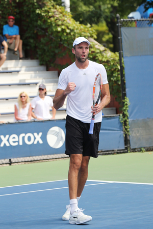 us open: NEW YORK - SEPTEMBER 1, 2015: Professional tennis player Ivo Karlovic of Croatia in action during his first round match at US Open 2015 at Billie Jean King National Tennis Center in New York