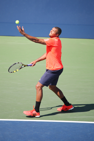 atp: NEW YORK - SEPTEMBER 6, 2015: Professional tennis player Jo-Wilfried Tsonga of France in action during his round four match at US Open 2015 at National Tennis Center in New York Editorial