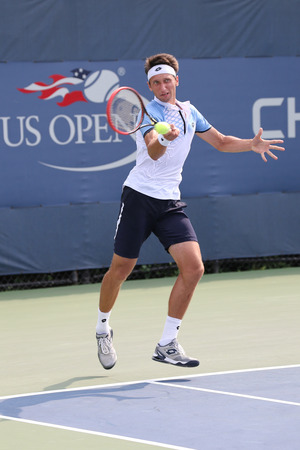 atp: NEW YORK - AUGUST 31, 2015: Professional tennis player Serhiy Stakhovsky of Ukraine in action during his first round match at US Open 2015 at Billie Jean King National Tennis Center in New York