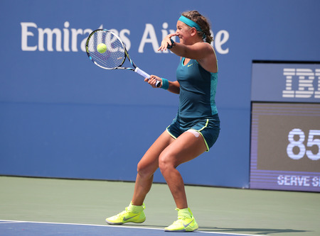 atp: NEW YORK - SEPTEMBER 3, 2015: Two times Grand Slam champion Victoria Azarenka of Belarus in action during US Open 2015 second round match at Arthur Ashe Stadium Editorial