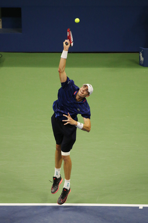 billie: NEW YORK - SEPTEMBER 7, 2015: Professional tennis player John Isner of United States in action during his fourth round match at US Open 2015 at Billie Jean King National Tennis Center in New York