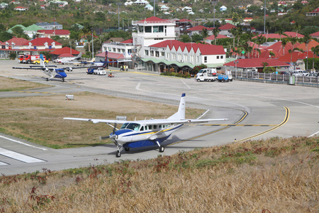 windward: ST. BARTHS, FRENCH WEST INDIES -JUNE 13, 2015: St Barth commuter aircraft ready to take off at St Barths airport. Windward Islands Airways celebrating 50 years of service. Editorial