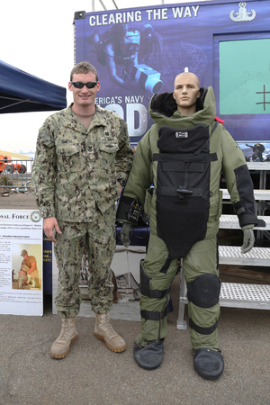 squad: NEW YORK - MAY 21, 2015: Navy Explosive Ordnance Disposal specialist with bomb squad suit during Fleet Week 2015 in New York
