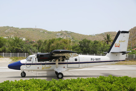 windward: ST. BARTHS, FRENCH WEST INDIES -JUNE 13, 2015:  Winair DHC-6 aircraft landed at St Barths airport. Windward Islands Airways celebrating 50 years of service.