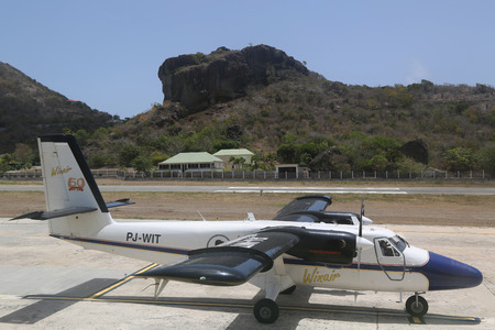 windward: ST. BARTHS, FRENCH WEST INDIES -JUNE 14, 2015:  Winair DHC-6 aircraft ready to take off at St Barths airport. Windward Islands Airways celebrating 50 years of service.
