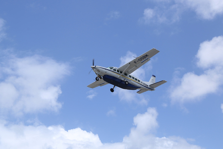 collectivity: ST. BARTS, FRENCH WEST INDIES - JUNE 12, 2015: St. Barth Commuter plane taking off from St Barts airport. St. Barts is considered a playground of the rich and famous. Editorial